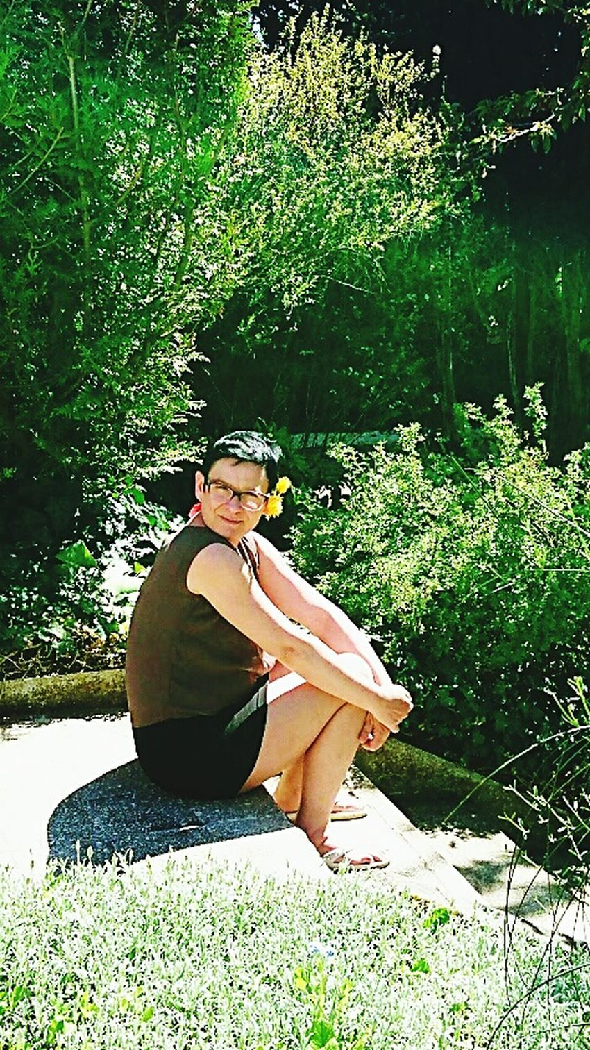 Sitting Full Length Young Adult Grass Casual Clothing Lifestyles Young Women Relaxation Rock - Object Leisure Activity Person Cross-legged Sunlight Plant Meditating Day Vacations Women Who Inspire You The Favorite Place Fav contemplation Summer Outdoors