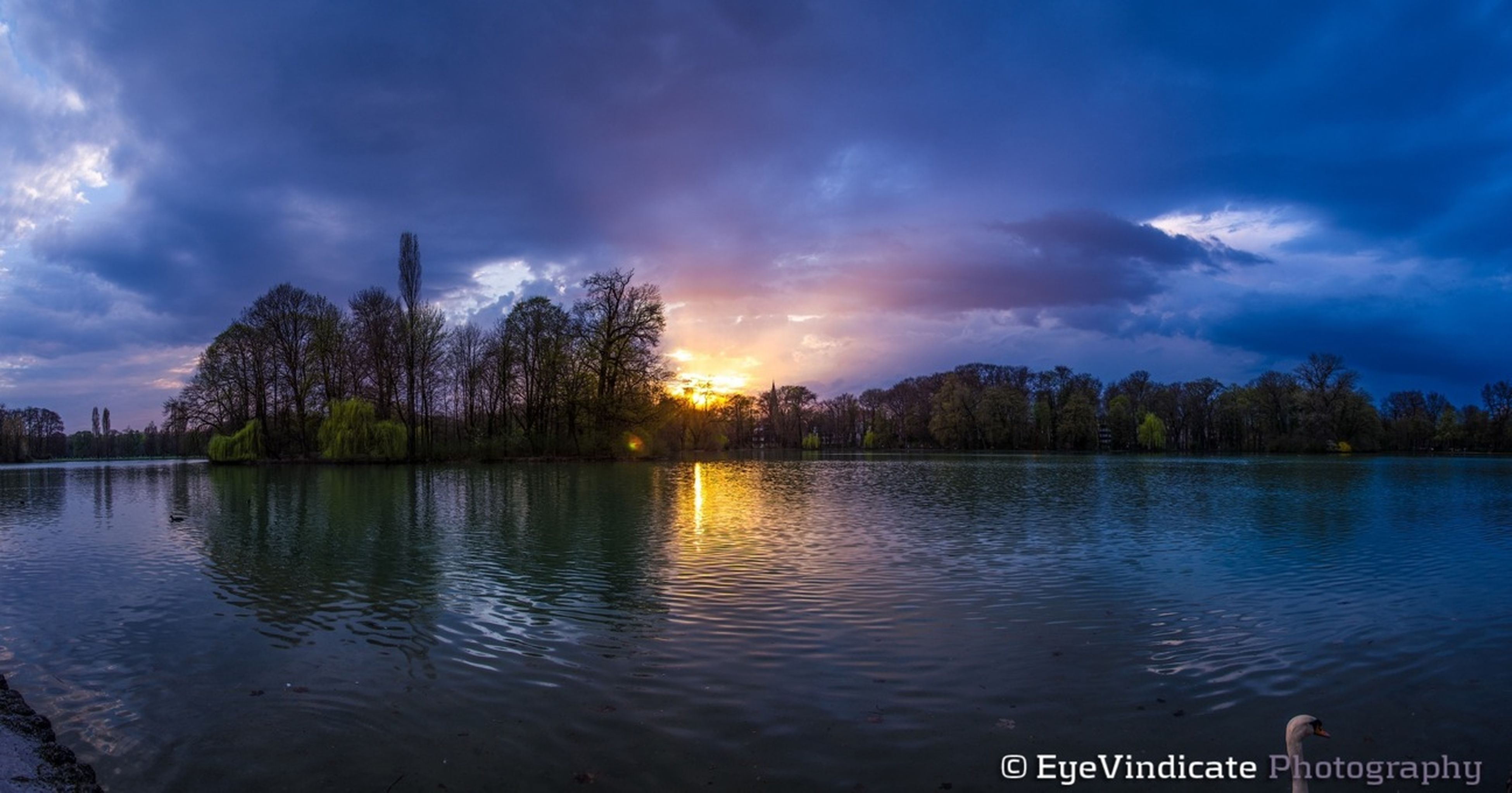 sky, water, sunset, tree, cloud - sky, waterfront, scenics, tranquil scene, tranquility, lake, beauty in nature, reflection, silhouette, building exterior, nature, built structure, cloud, architecture, river, cloudy