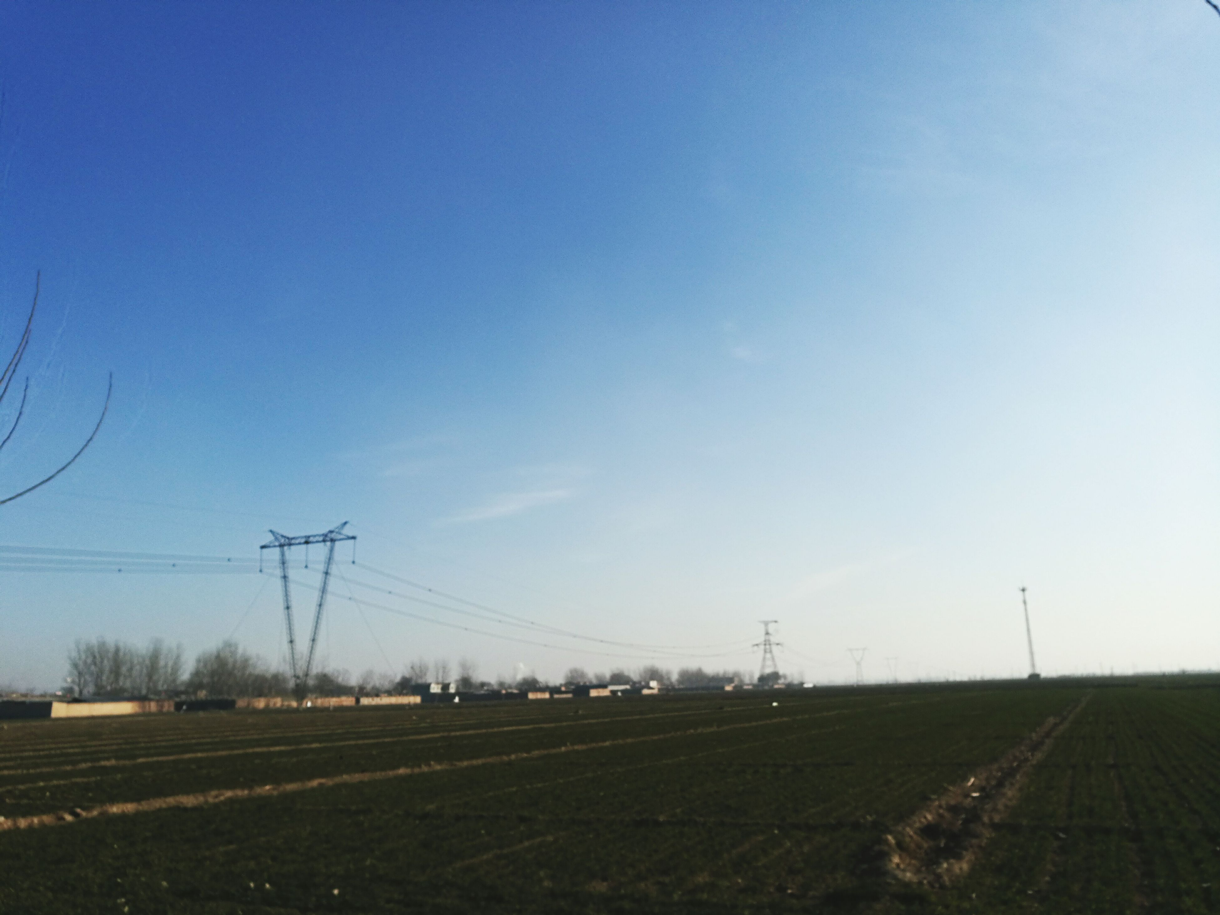 Electricity  Fuel And Power Generation Power Supply Clear Sky Electricity Pylon Blue Power Line  Sky Landscape Cable Outdoors No People Tranquility Day Technology Renewable Energy Alternative Energy Grass Nature