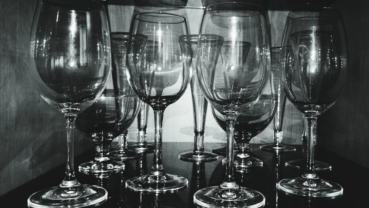wineglass, still life, indoors, table, drinking glass, alcohol, no people, food and drink, arrangement, wine, illuminated, close-up, day