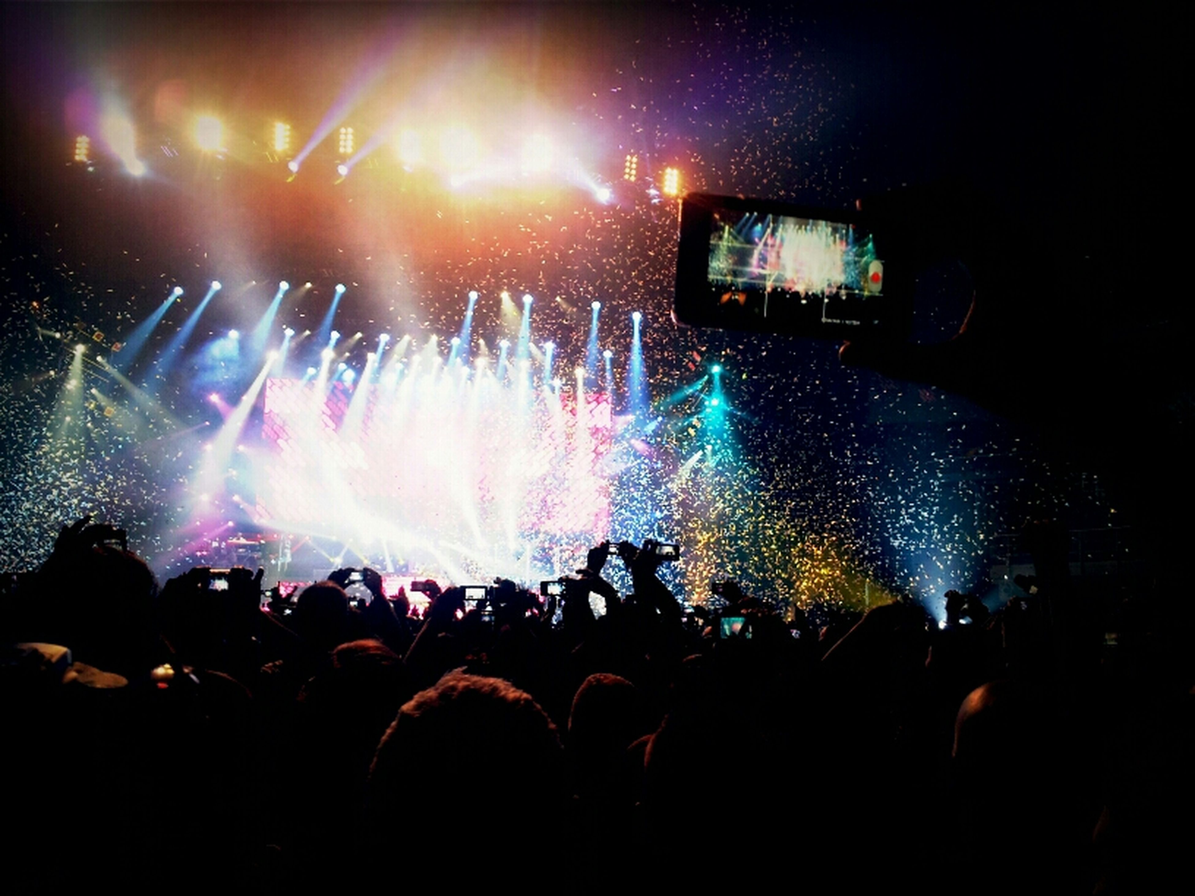 large group of people, arts culture and entertainment, music, crowd, event, person, concert, performance, nightlife, music festival, enjoyment, illuminated, popular music concert, youth culture, fun, stage - performance space, men, stage light, excitement