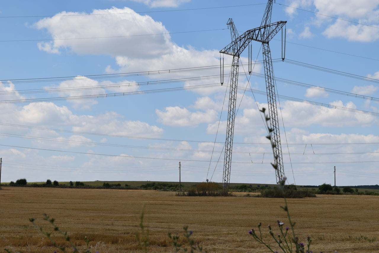 Cable Cloud - Sky Connection Day Electricity  Electricity Pylon Electricity Tower Field Landscape Nature No People Outdoors Power Supply Sky Village Wheat Field