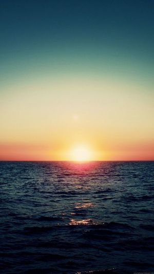 Sunset Sea Horizon Over Water Water Tranquility Clear Sky Scenics Sunlight Beauty In Nature Tranquil Scene Sun Multi Colored Outdoors Nature No People Sky Beach Day