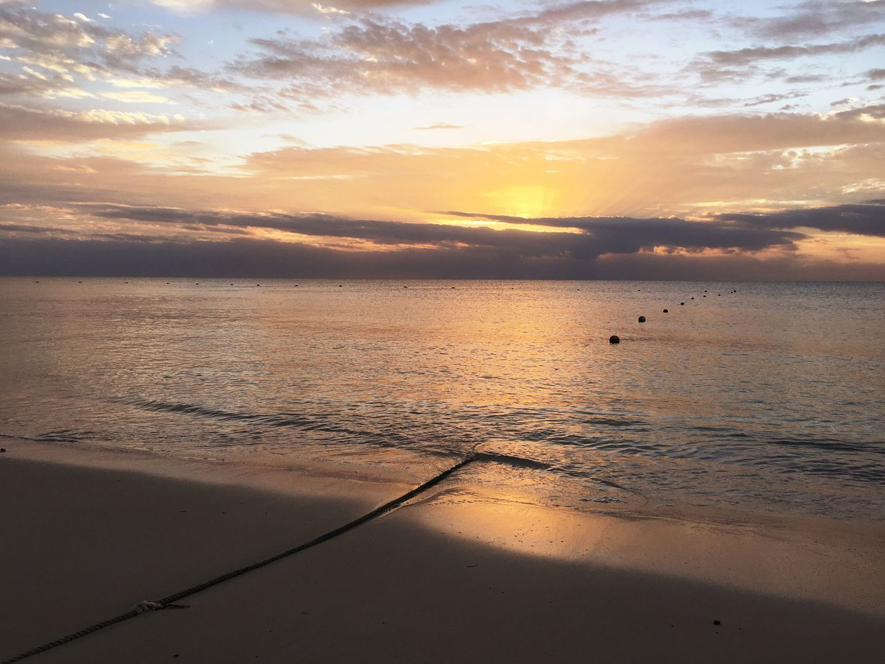 sunset, beauty in nature, sea, scenics, nature, water, orange color, sky, tranquil scene, beach, cloud - sky, sun, horizon over water, tranquility, no people, sunlight, outdoors, travel destinations, bird, day