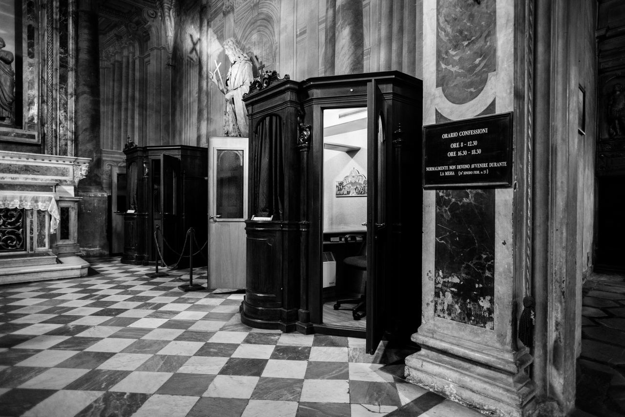 Confession booth in a roman church with light inside and a billboard next to it Architecture Blackandwhite Building Exterior Built Structure Chequered Church Confession Day No People Outdoors Roma Sins Taking Photos Text Travel
