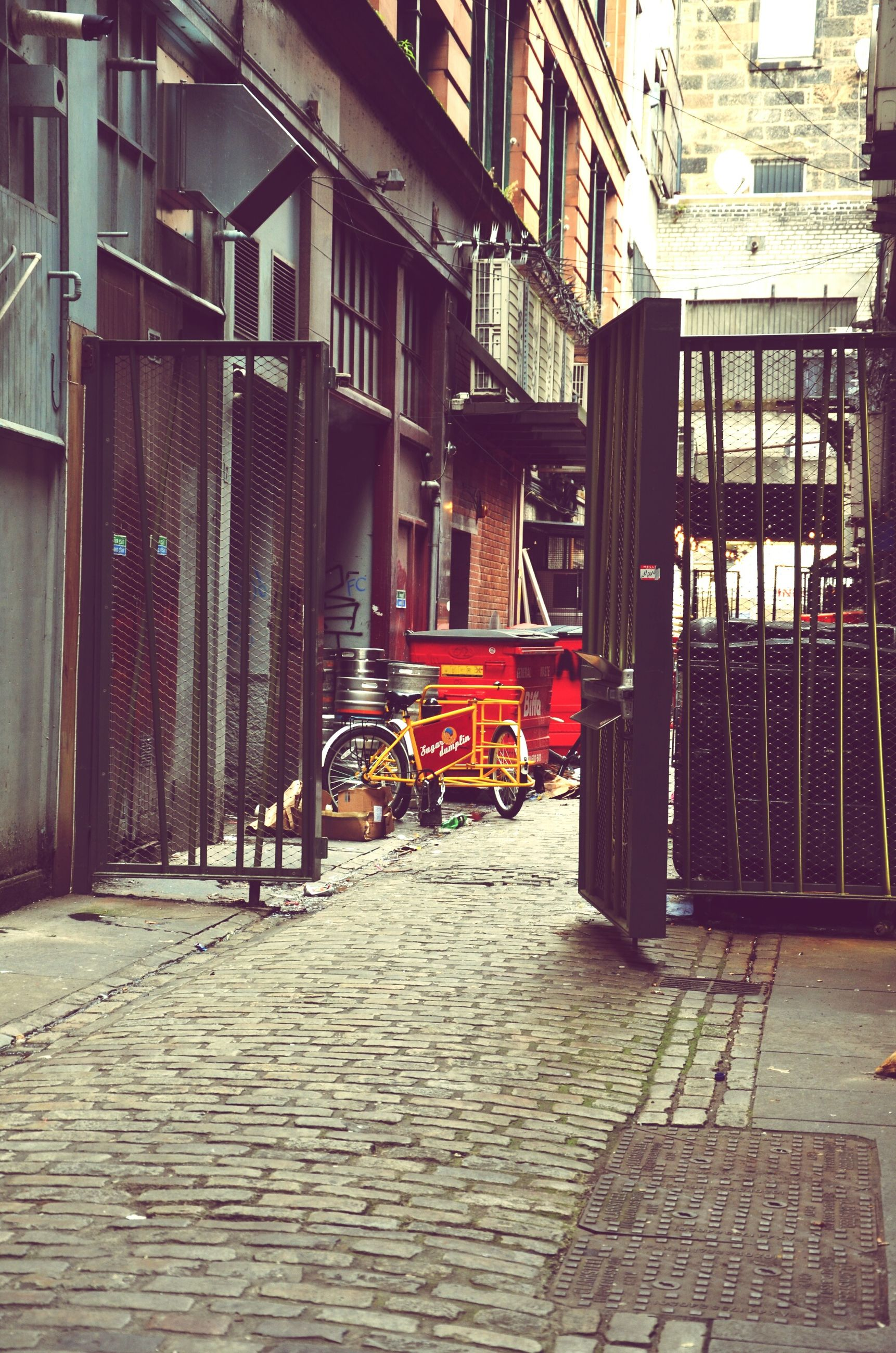 architecture, built structure, building exterior, transportation, bicycle, street, window, residential building, house, land vehicle, mode of transport, narrow, day, stationary, the way forward, outdoors, parked, cycle