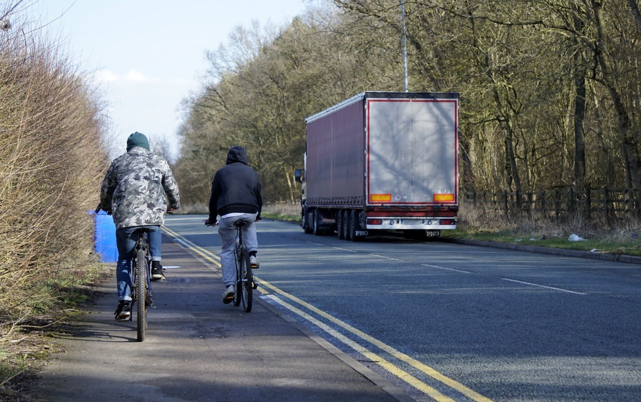 9963 Adult Adults Only Bicycle Bicycles Cold Day Fence Hgv Lorry No Cars  Occupation Only Men Outdoors Pathway People Road Sky Sky And Clouds Sky Trees And Clouds Transportation Tree Trees Uk Yellow Lines
