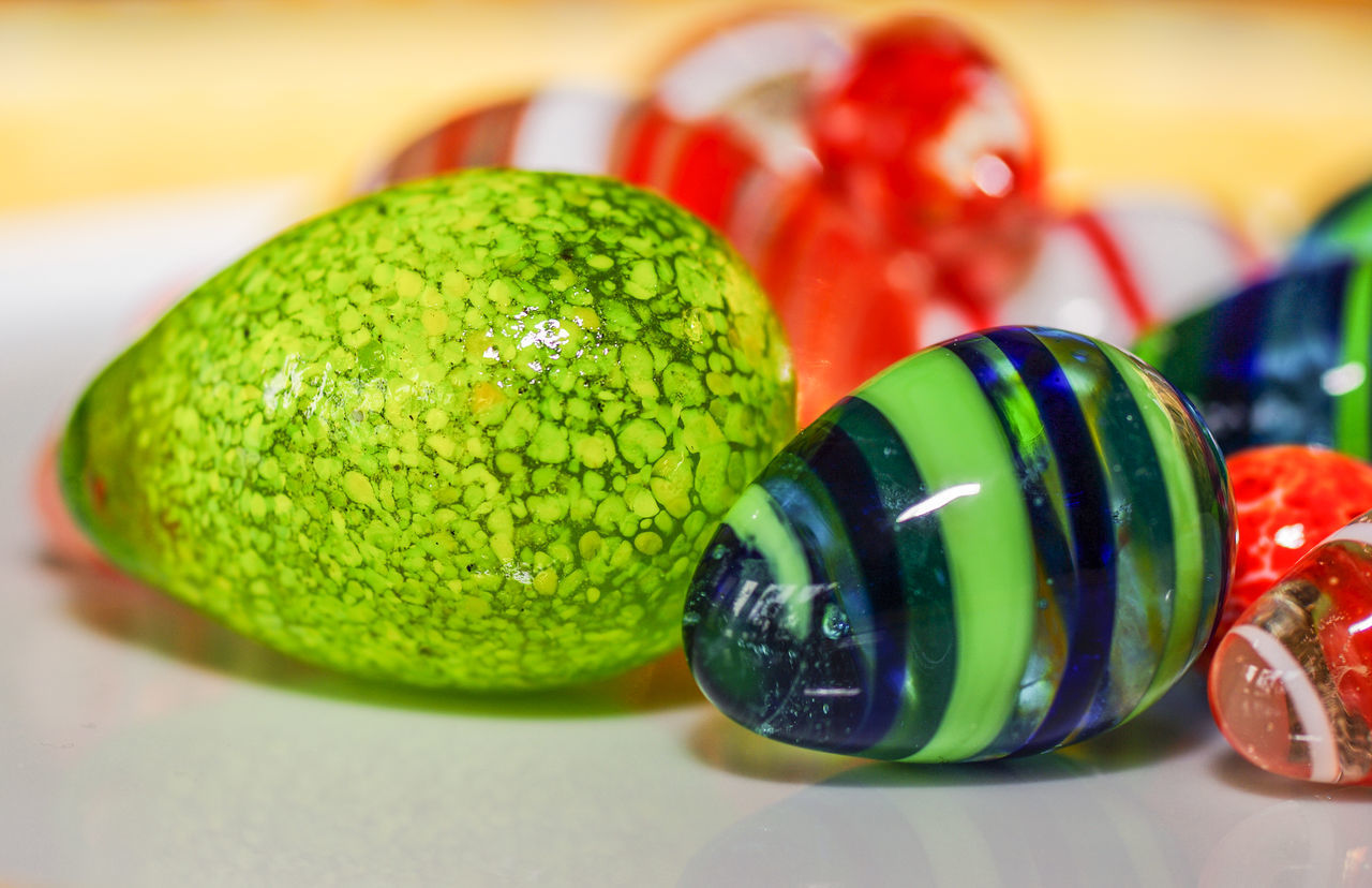still life, indoors, close-up, green color, table, multi colored, food, food and drink, focus on foreground, no people, variation, marbles, freshness, healthy eating, day