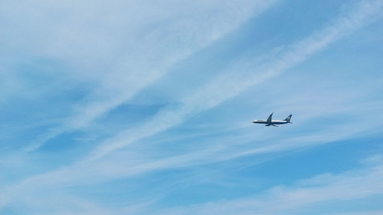 flying, airplane, sky, low angle view, transportation, blue, journey, no people, day, outdoors