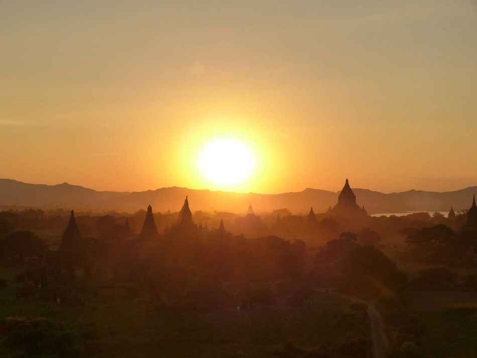 AdventurexculturesxDiscover Your CityxEarthxglobetrottingxHanging OutxHikingxLifexLifestylexNaturexnature_collectionxpeople PhotographyxsunsetxTravelx Bagan Beauty In Nature Idyllic Landscape Mist Mountain Mountain Range Myanmar Nature Nature Non-urban Scene Orange Color Scenic View Scenics Sky Sun Sunbeam Sunlight Sunset Temples Tourism Tranquil Scene Tranquility Travel Destinations