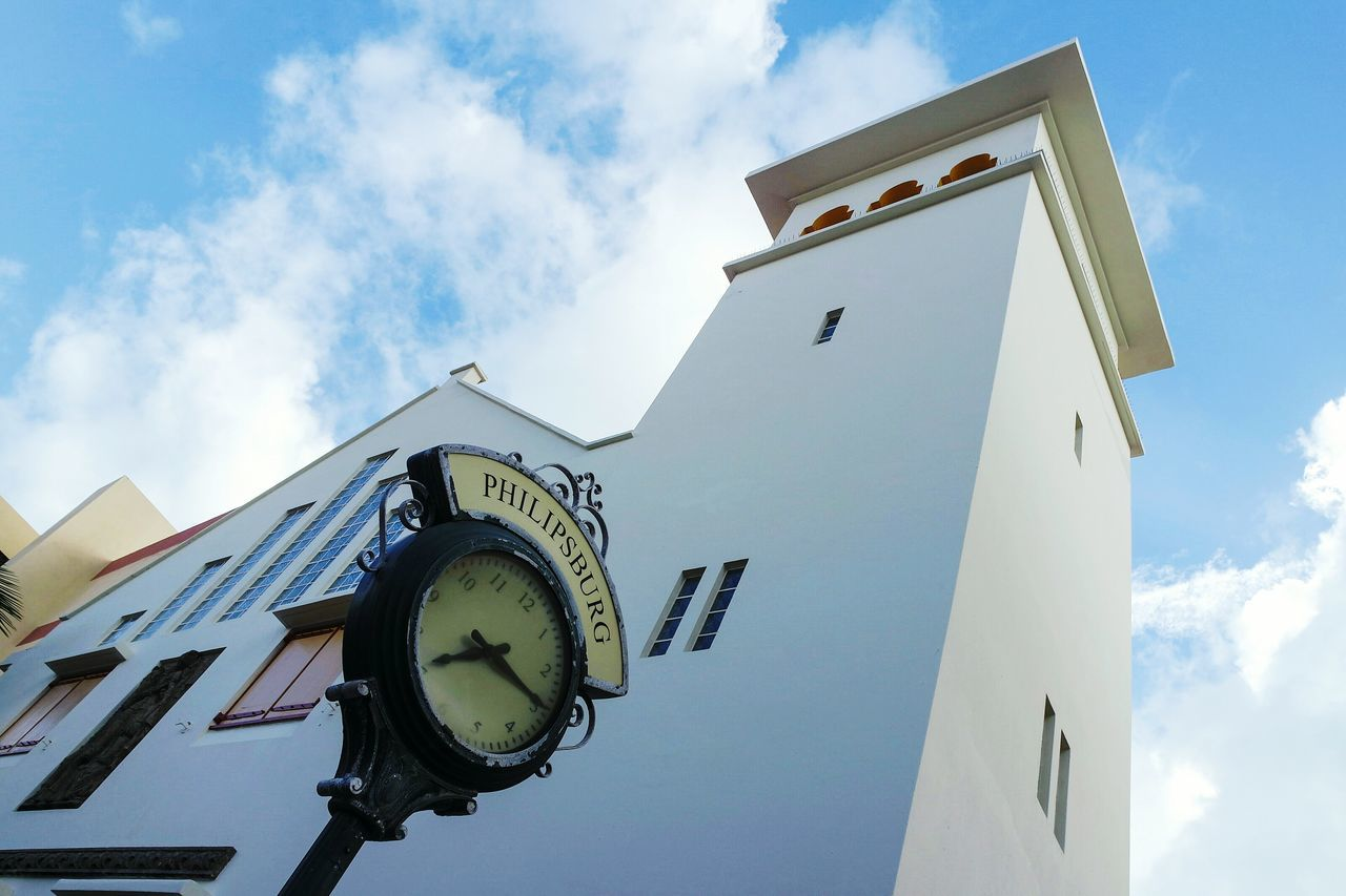 Lookingup in Philipsburg Low Angle View Sky Clock Time Cloud - Sky No People Outdoors Clock Face Minute Hand Day Astronomy Clock Tower Eye4photography  Open Edit EyeEm Best Shots Travel Destinations Fresh 3 Cityscape Building Exterior Architecture Building Structures Miles Away Minimalist Architecture