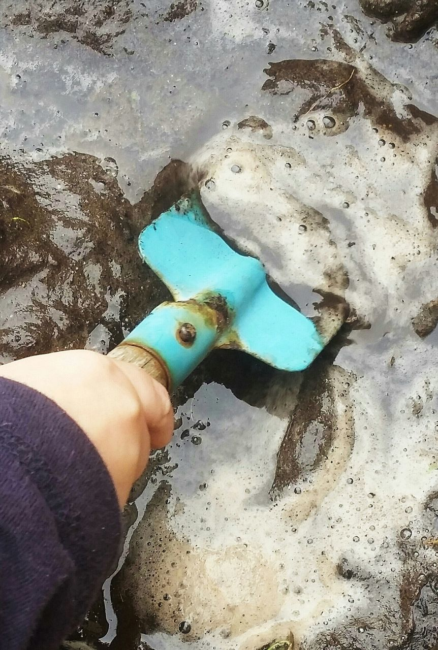 Hand With Shovel In Mud