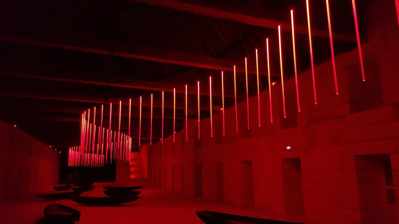 in a row, indoors, no people, illuminated, place of worship, architecture, day