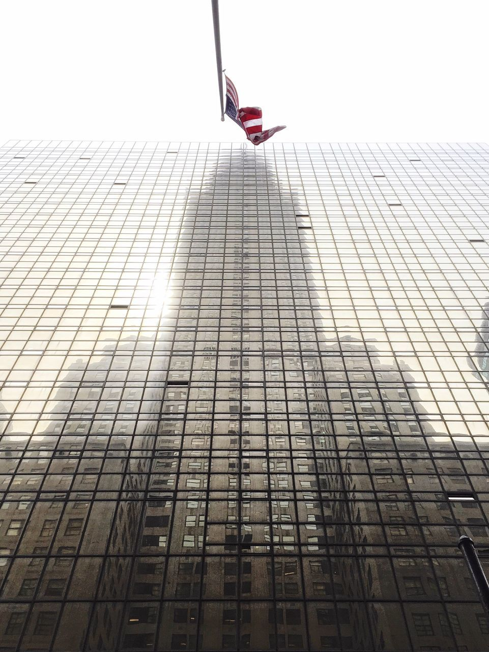 Reflection Of Chrysler Building On Glass