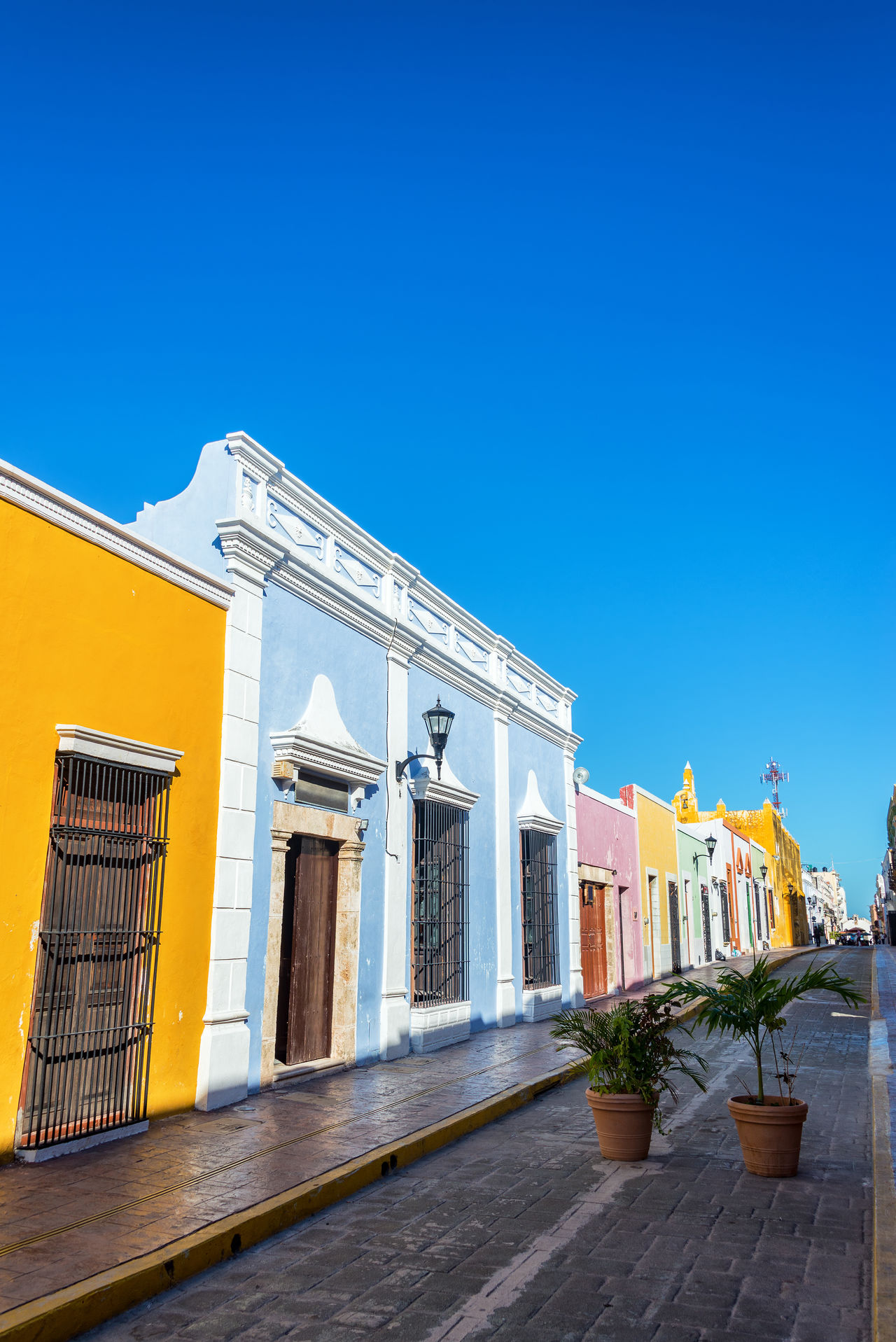 Vertical view of colorful colonial architecture in Campeche, Mexico America Architecture Building Campeche Caribbean City Cityscape Colonial Downtown Heritage Historic Houses Landmark Latin Mexican Mexico Spanish Square Street Town Unesco UNESCO World Heritage Site Urban Yucatan Mexico Yúcatan