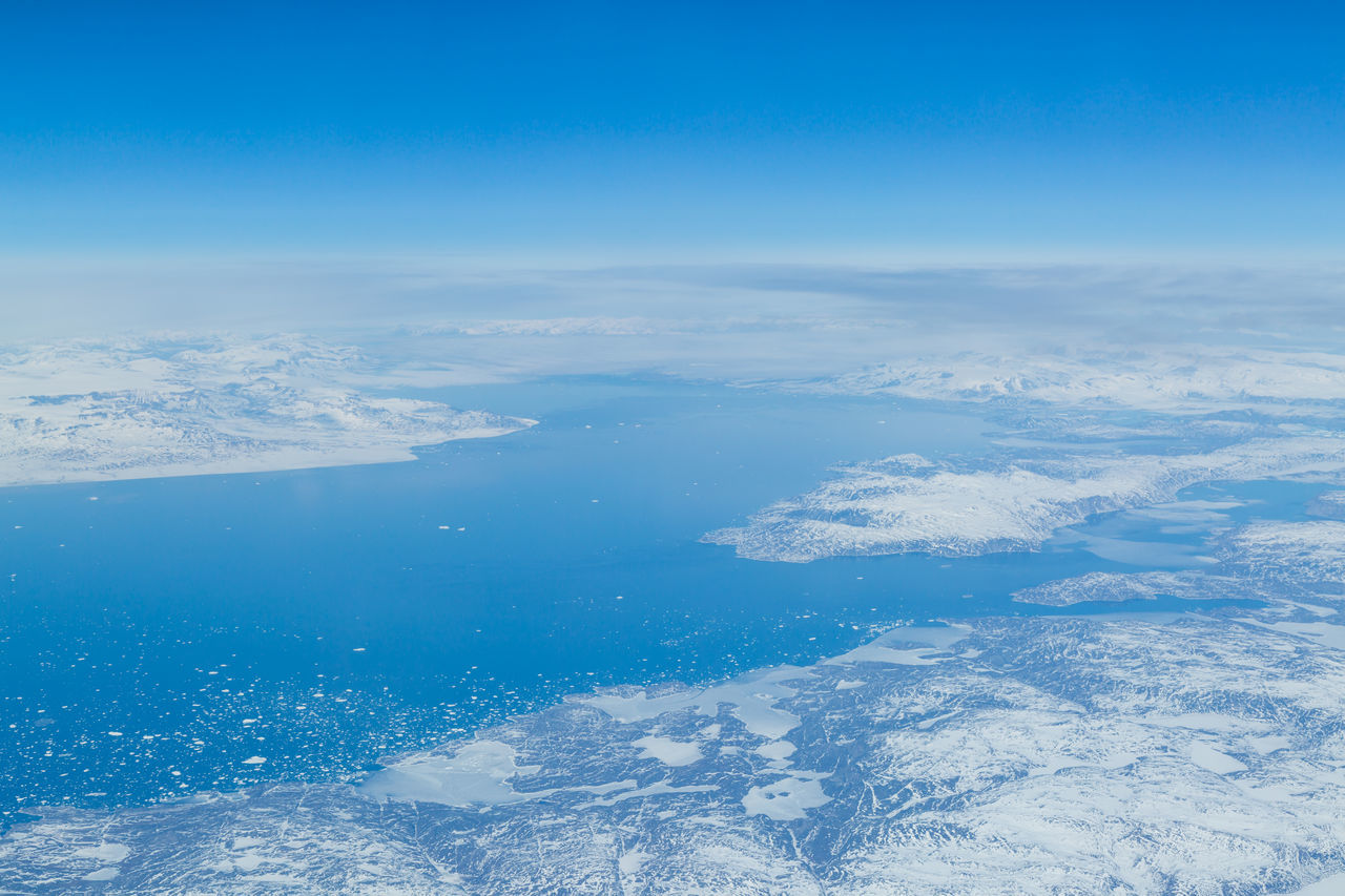Aerial View Of Frozen Sea Against Blue Sky