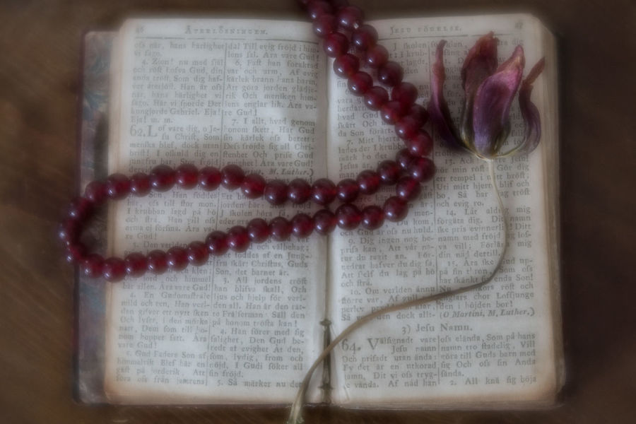 Old book of hymns Rosary Dried Flower Hymn Book Indoors  No People Spirituality Still Life Table Text
