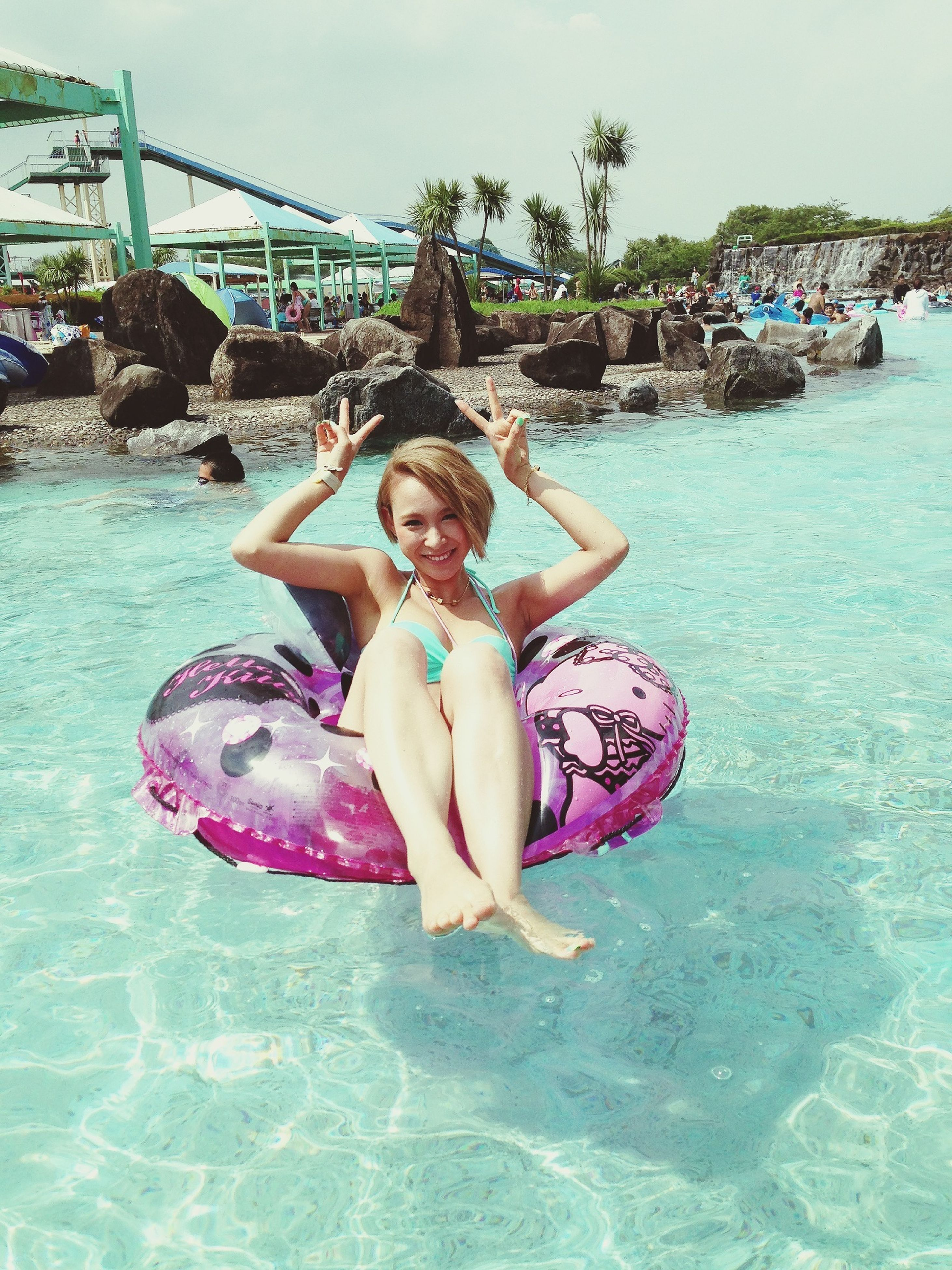 water, leisure activity, person, childhood, lifestyles, enjoyment, elementary age, fun, looking at camera, happiness, smiling, portrait, full length, sea, girls, sitting, casual clothing, boys