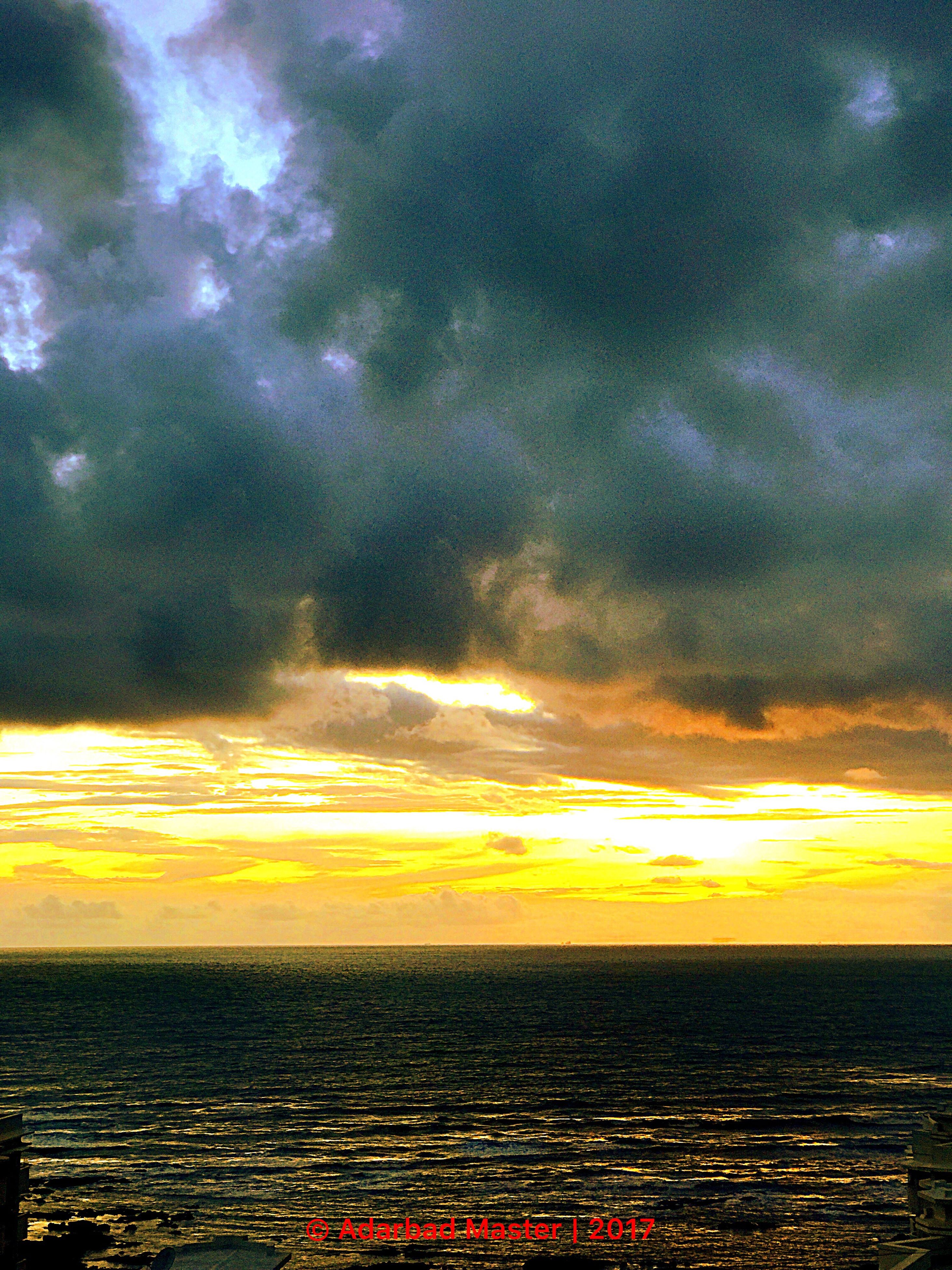 sky, cloud - sky, scenics, sunset, sea, horizon over water, beauty in nature, tranquility, nature, water, tranquil scene, outdoors, no people, yellow, day