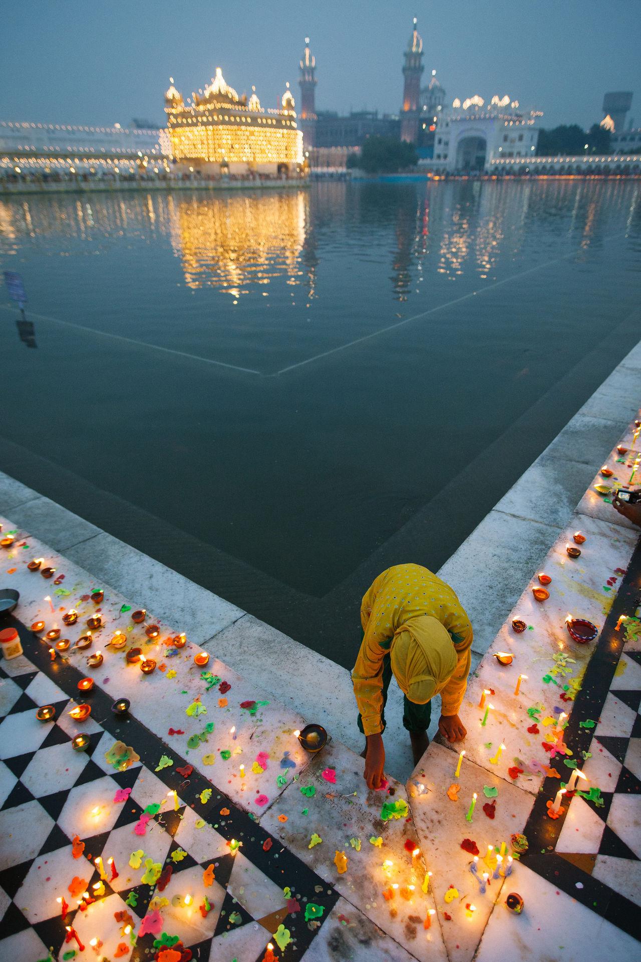 Water Architecture Outdoors Night Diwali Pool India Indian Sikhism Gurudwara Golden Temple Punjab Amritsar Built Structure Gold Temple Candle Light Kid