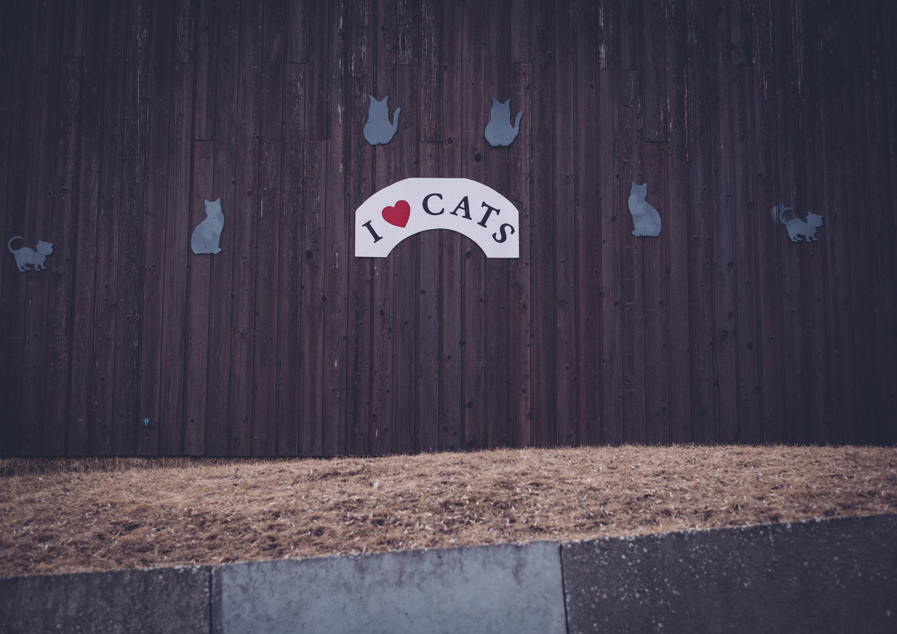 Building Building Exterior Communication Day Grass I Love Cats No People Outdoors Sign Text Wall Wood - Material