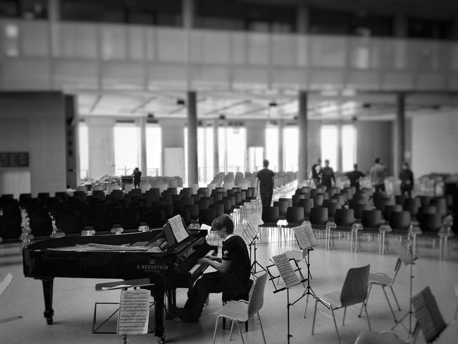 Auditorium Lecture Hall Sitting One Person piano black white concert rehearsal Tranquility Architecture