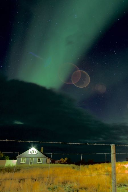 EyeEmNewHere Iceland Northern Lights Beauty In Nature Cabanne Fence Night No People Outdoors Scenics Star - Space Wooden House Perspectives On Nature
