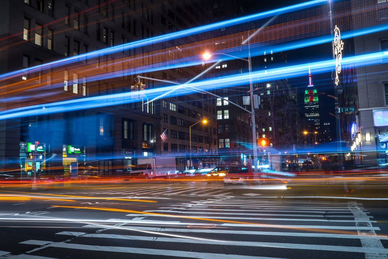 Night Illuminated Speed Transportation Motion City Architecture Traffic Building Exterior Light Trail No People Built Structure Long Exposure Outdoors Road Sky