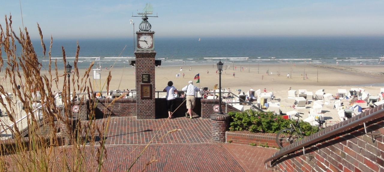 At The Beach Clock Towers Germany Island Of Wangerooge Outdoors Pavement Perspective Side By Side View From Above