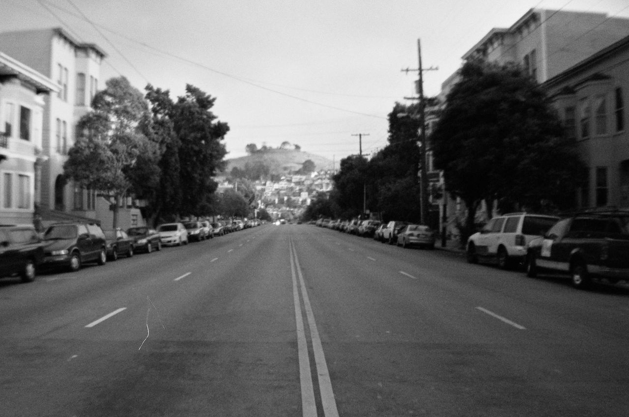 middle of the road 35mm Film Analogue Photography Architecture Bernal Heights Building Exterior Built Structure City Clear Sky Copy Space Day Film Photography Filmisnotdead Middle Of The Street Mode Of Transport New Topographics No People Outdoors Parked Cars Road San Francisco Sky Street Street Parking Street Photography The Way Forward