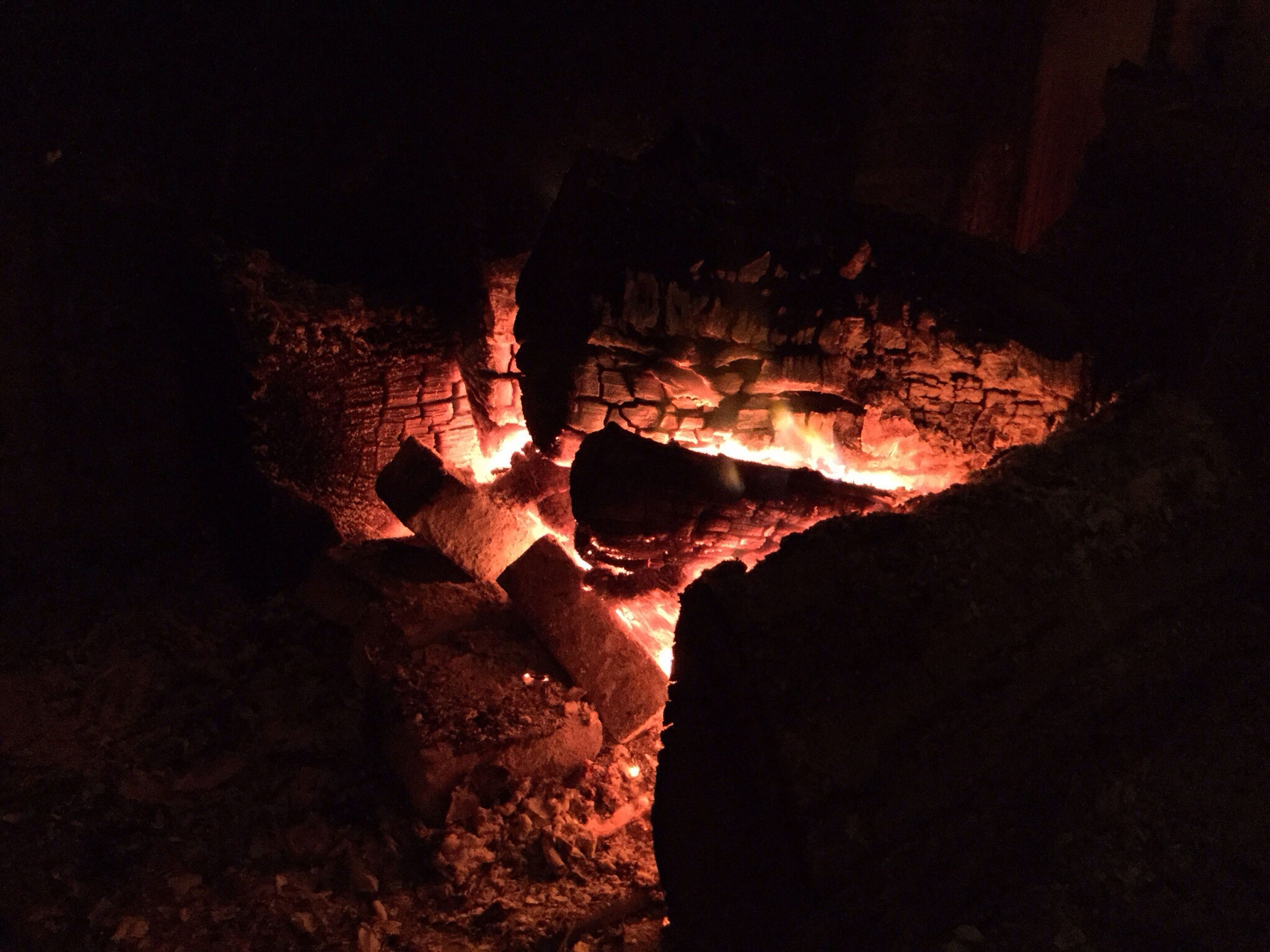 night, rock - object, rock formation, textured, cave, dark, geology, indoors, close-up, rough, pattern, nature, no people, natural pattern, eroded, heat - temperature, destruction, low angle view, firewood