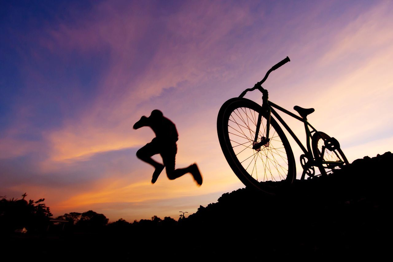 Silhouette Sunset Action Bicycle Real People Men Leisure Activity Sky Outdoors Lifestyles Nature One Person Day People Bycicle Jump Jumping Sunset Silhouettes Silhouette Sport Sports Cloud - Sky Cloud Freestyle Activity