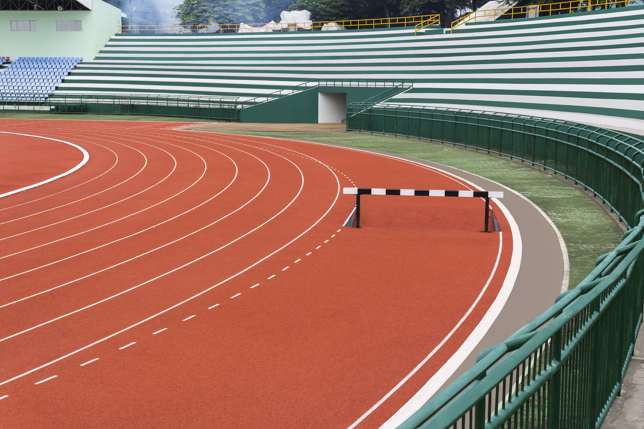 Hurdle on red running track Racetrack Athlete Compitition Course Curve Design Exercise Lane Obstacle Rececourse Rubber Speed Sport Sprint Stadium Track Track And Field Track And Field Stadium Winner