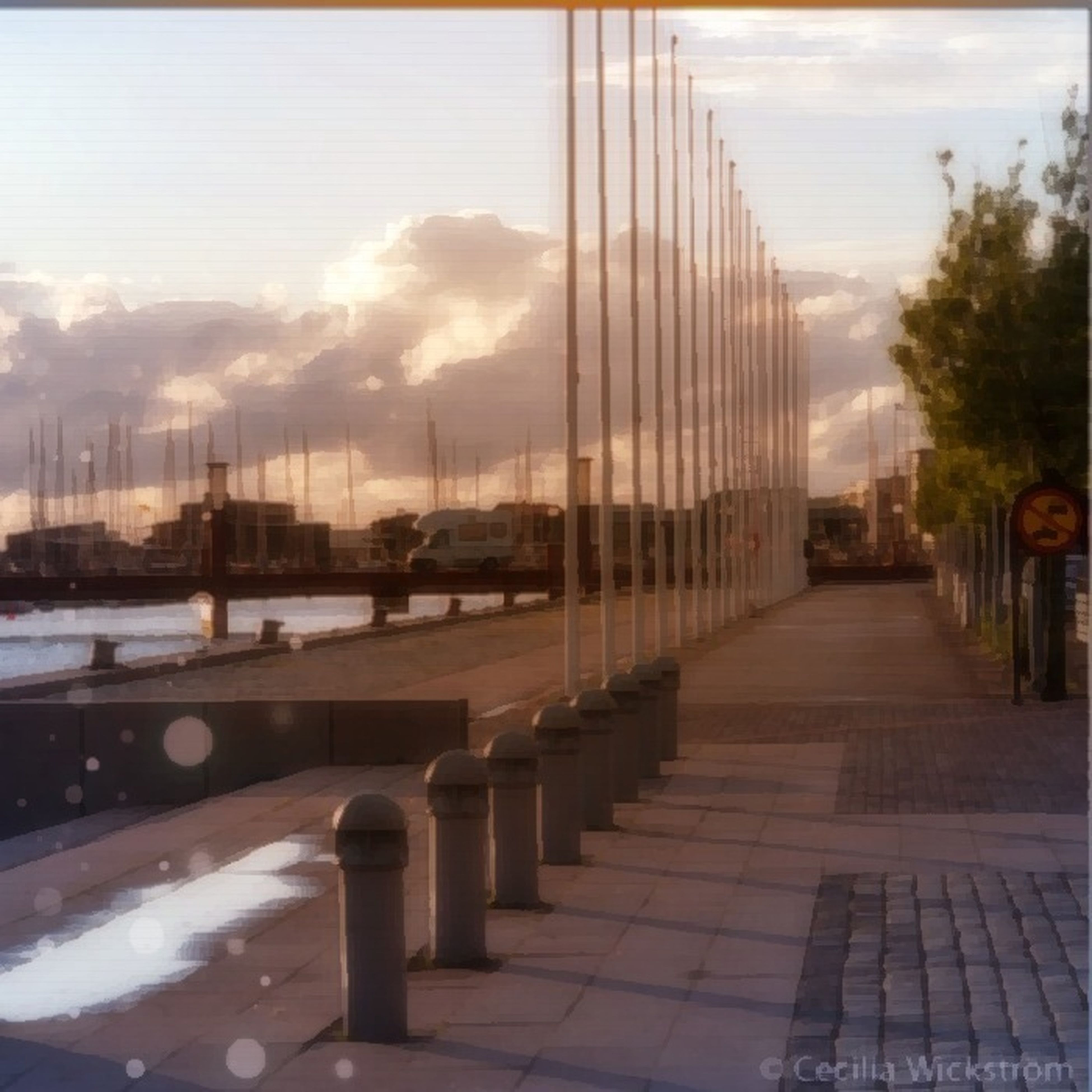 architecture, sky, built structure, cloud - sky, the way forward, city, building exterior, connection, cloudy, bridge - man made structure, transportation, cloud, railing, diminishing perspective, reflection, sunlight, road, incidental people, street light, empty