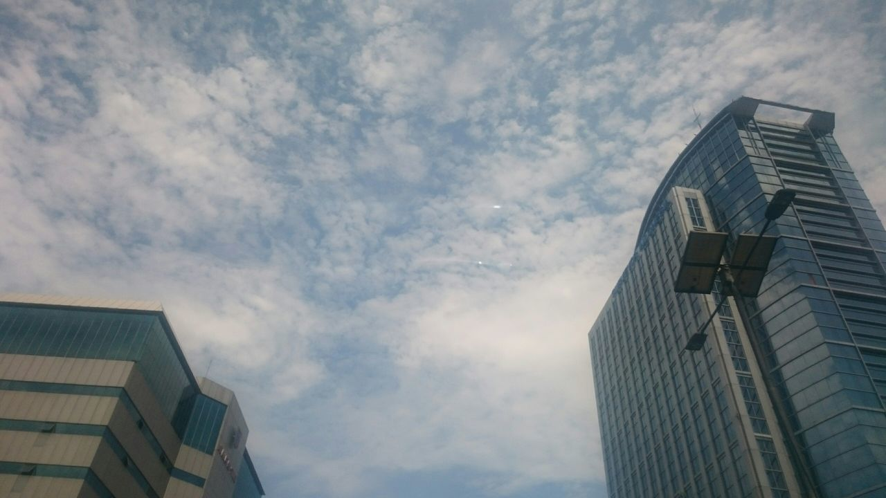 architecture, building exterior, built structure, low angle view, sky, skyscraper, modern, outdoors, day, no people, cloud - sky, city