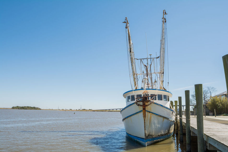 Shrimping boat tied up to dock Fishing Fishing Boat Gulf Coast Gulf Of Mexico Ocean Shrimp Boat Shrimping Vintage