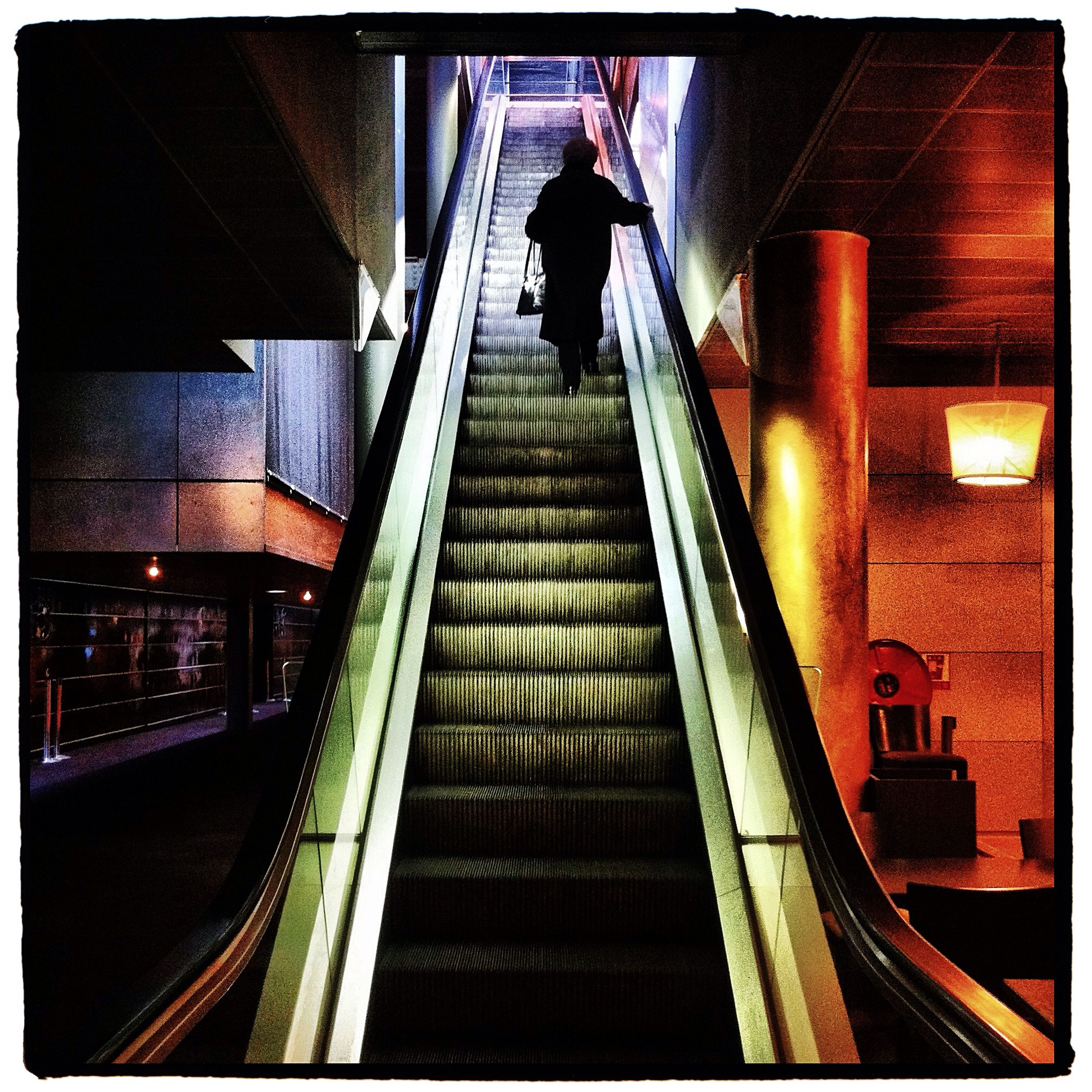 steps, indoors, steps and staircases, escalator, transfer print, staircase, railing, architecture, illuminated, built structure, men, auto post production filter, the way forward, subway, railroad station, lifestyles, rail transportation, railroad station platform