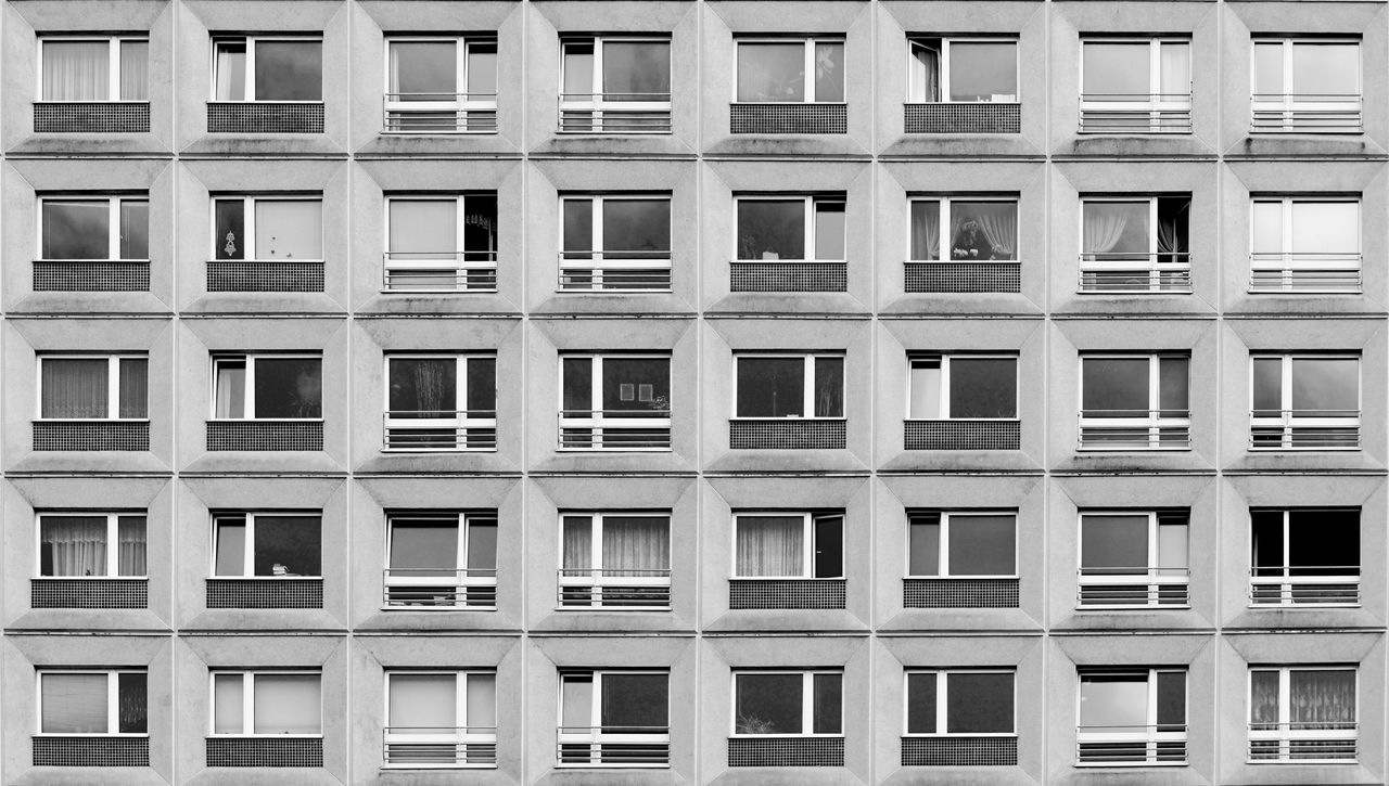 windows in a row in Berlin, Grmany Architecture Backgrounds Full Frame In A Row Monochrome No People Pattern Platte Plattenbau Repetition Residential Building Row Symmetry Window Windows