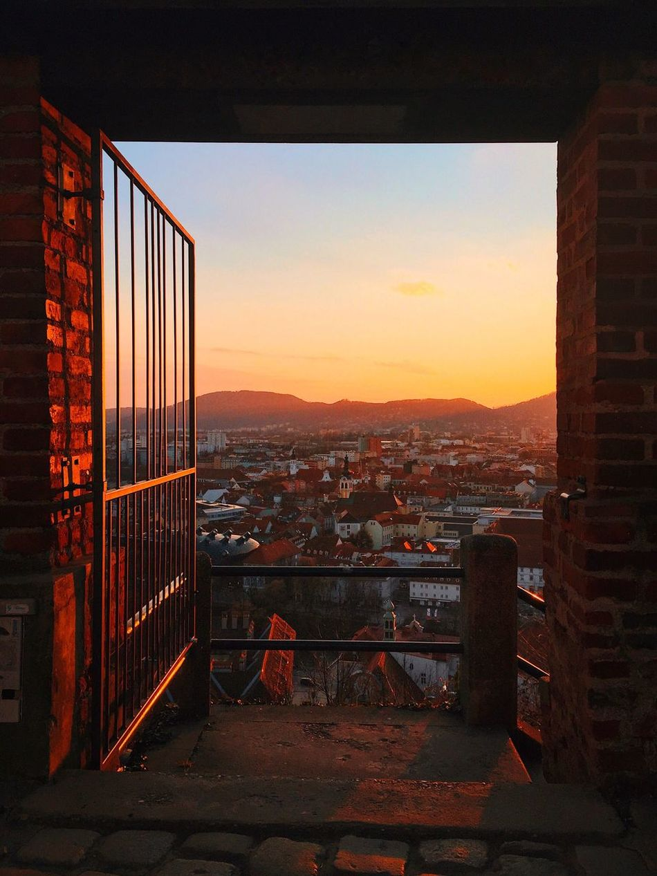 Sunset Orange Color Sky Architecture Cityscape Built Structure No People Building Exterior Window City Outdoors Clear Sky Mountain Nature Day Autumn Fall
