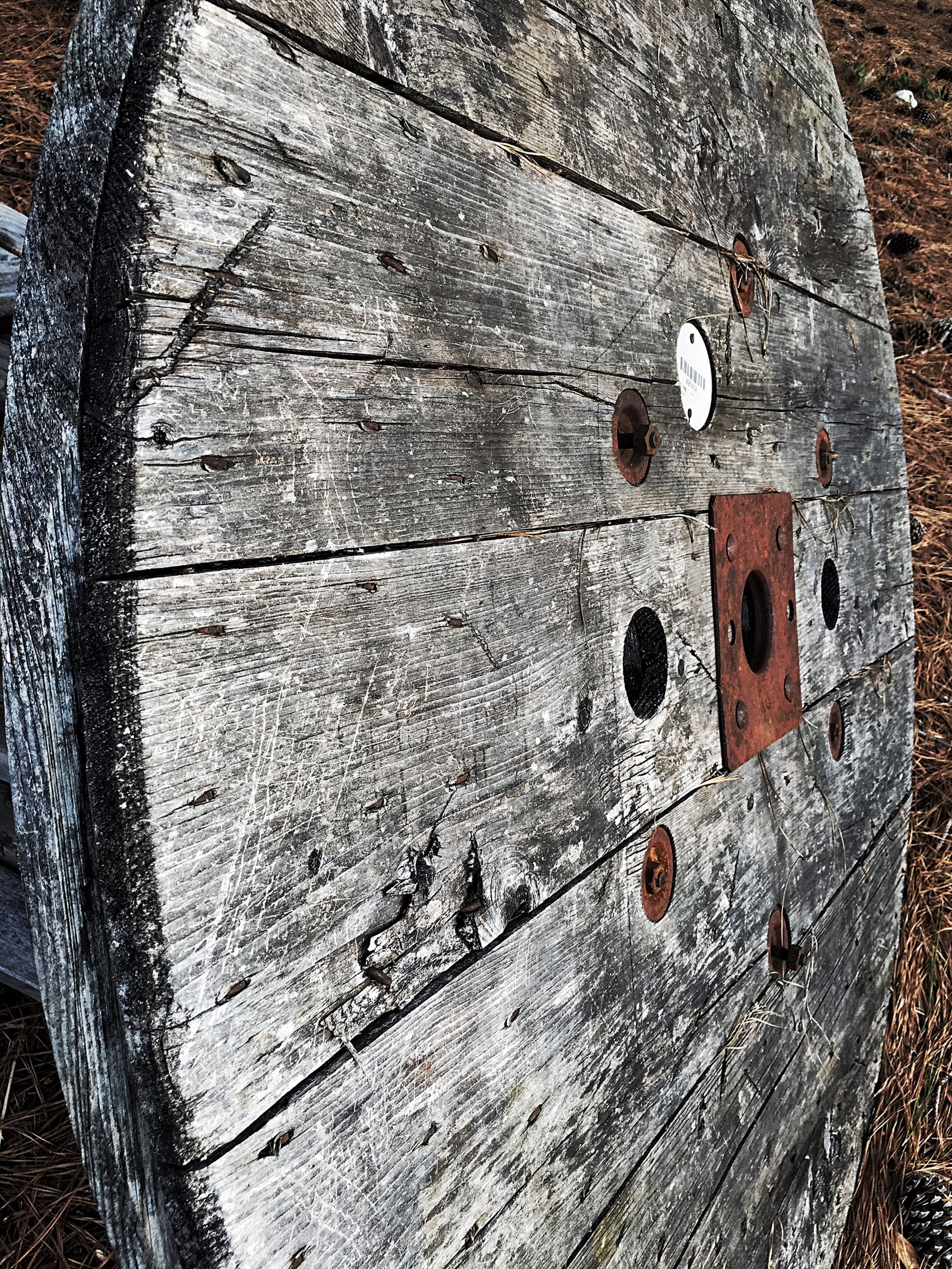 wood - material, abandoned, damaged, close-up, wooden, old, obsolete, textured, high angle view, wood, weathered, run-down, deterioration, rusty, plank, day, outdoors, broken, no people, hole