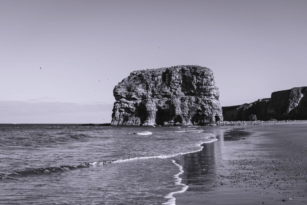 Marsden Rock Sea Water Nature Rock - Object Beauty In Nature Scenics Clear Sky Tranquil Scene Tranquility No People Beach Horizon Over Water Outdoors Day Sky Nikond750 Nikon24-85vr Landscape Blackandwhite Photography Eye4photography  Betterlandscapes