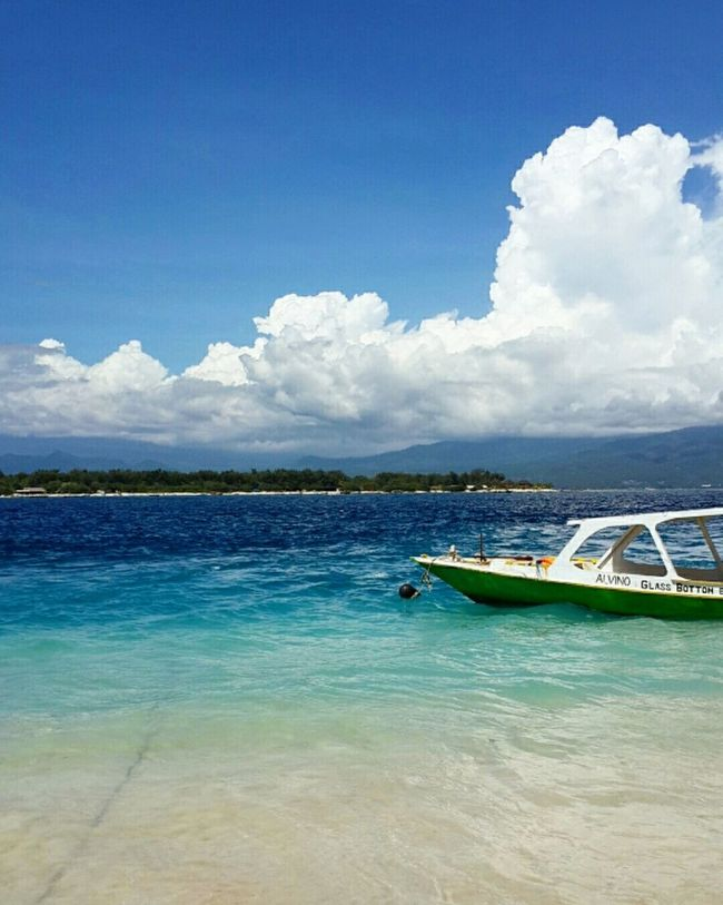 Intriguing shade of blue ocean in Gili Trawangan, Lombok. One of the beautiful oceans in Indonesia Water Sky Blue Tranquil Scene Cloud - Sky Seascape Nature Beauty In Nature Sea Sea And Sky Lombok Island Gili Trawangan Seaside Sea View Smallboat Nautical Vessel Boat Scenics Tranquility Calm Cloud Blue Sea Blue Sky First Eyeem Photo