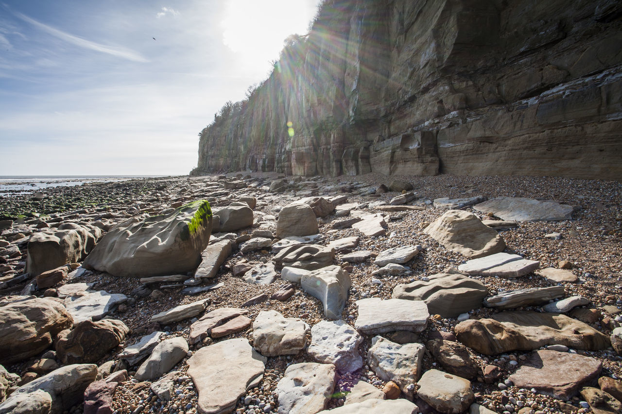 Against The Sun Beauty In Nature Coastline English Coastline Fossils And Rocks Giant Rocks Nature_collection Panoramic Landscape Panoramic View Pebble Beach Rock Formation Sandstone Cliffs Seaside Strange Shapes Sunshine