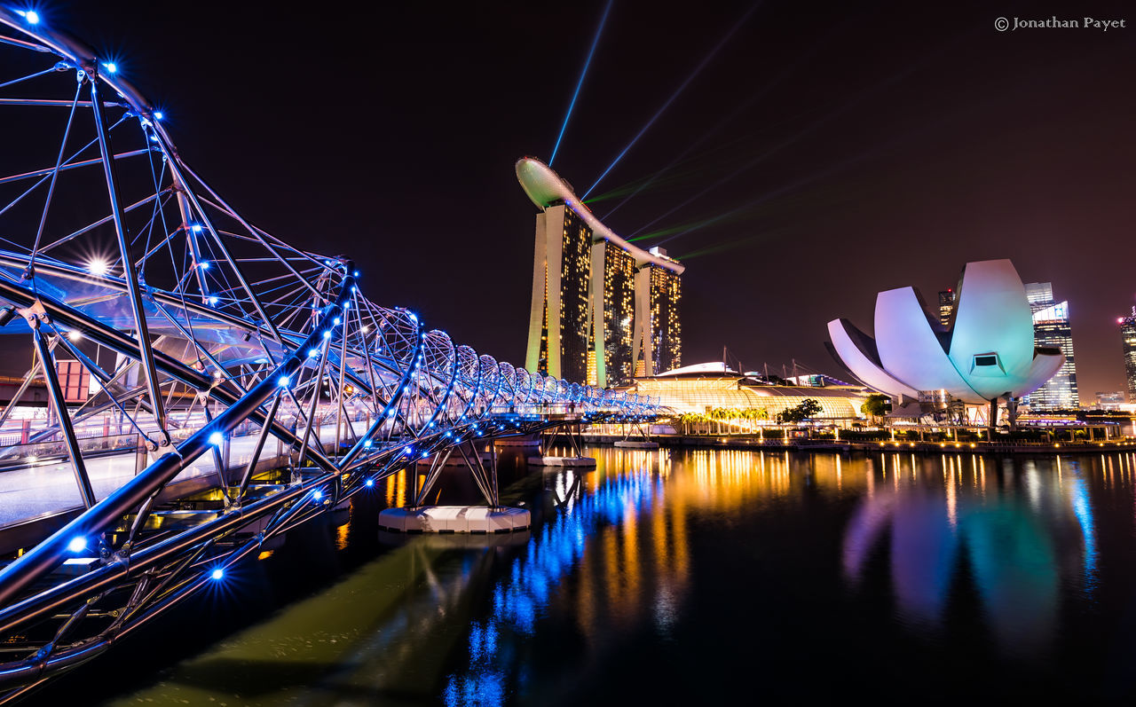 night, illuminated, architecture, built structure, reflection, water, travel destinations, connection, transportation, building exterior, river, bridge - man made structure, waterfront, outdoors, no people, sky, city