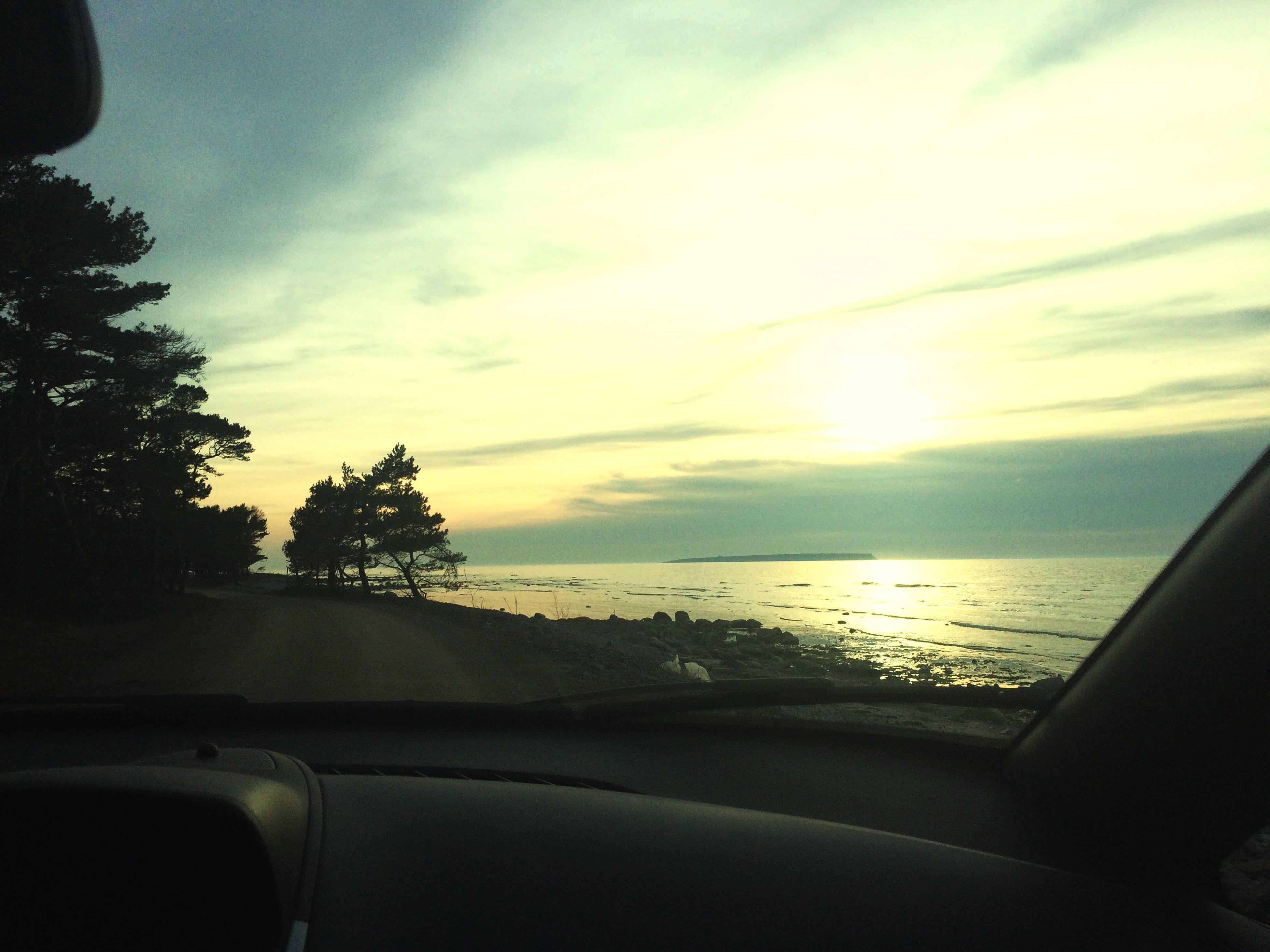 sea, sky, horizon over water, sunset, water, transportation, scenics, cloud - sky, mode of transport, beauty in nature, tranquil scene, beach, tranquility, nature, cloud, nautical vessel, shore, sun, idyllic, car