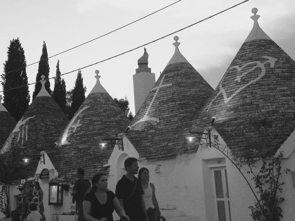 Alberobello Alberobello - Puglia Alberobello City Alberobellocity Alberobelloexperience Alberobellophotocontest Architecture Building Exterior Built Structure Day History Lifestyles Men Outdoors Place Of Worship Real People Religion Sky Spirituality Tree Women