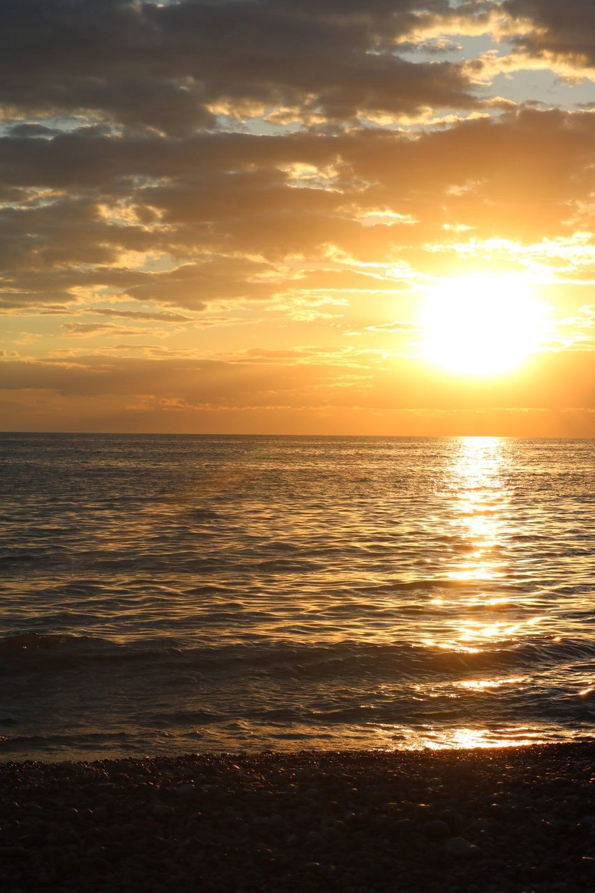 sunset, sea, sun, scenics, beauty in nature, nature, water, tranquility, sunlight, tranquil scene, idyllic, sky, beach, reflection, horizon over water, silhouette, no people, holiday, outdoors