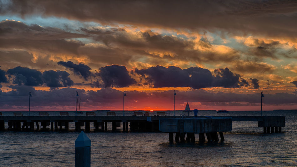 Key West Sunset Beauty In Nature Cloud - Sky Dramatic Sky Florida Key West Mallory Square Nature Pier Sailboat Sea Sky Sunset Sunset_collection Water