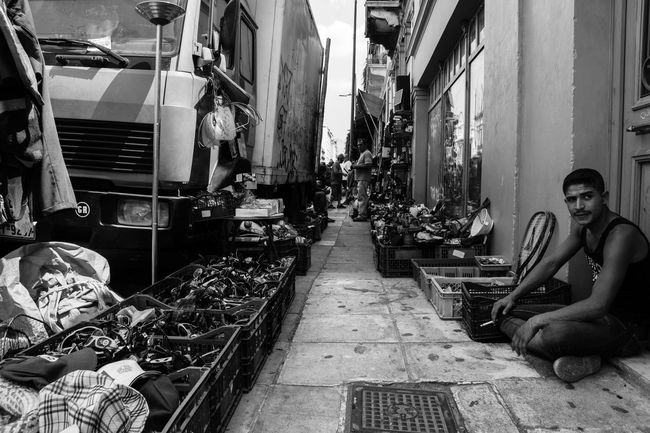 Real People Athens Athens, Greece Blackandwhite Building Exterior Built Structure City City Life Day Flea Markets Fleamarket Footpath Greece Long Market Messy Narrow Outdoors People People Of The World Street Photography Streetphotography The Way Forward Untidiness Untidy