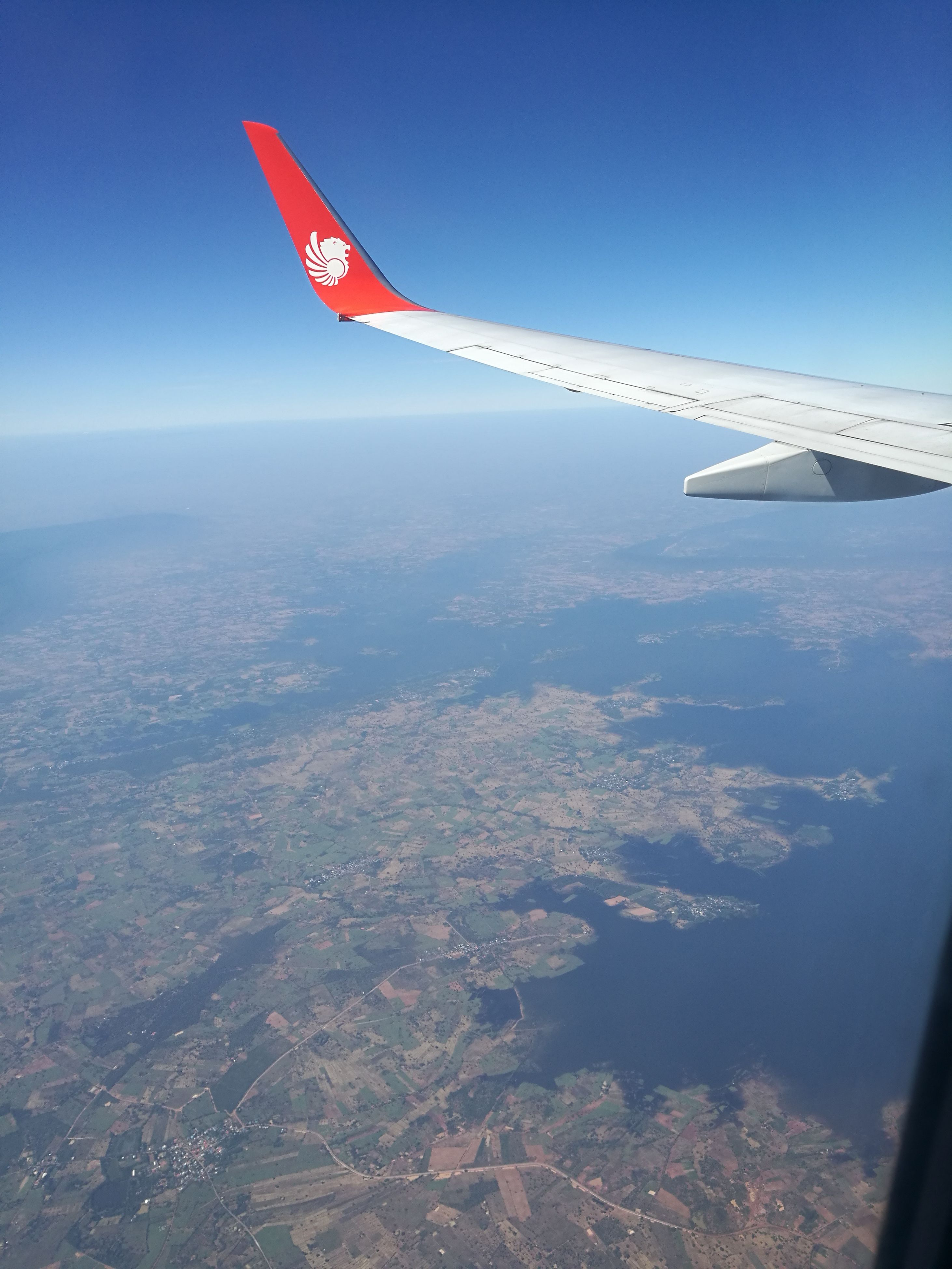 airplane, flying, transportation, aircraft wing, sky, air vehicle, no people, day, water, outdoors, nature, airplane wing